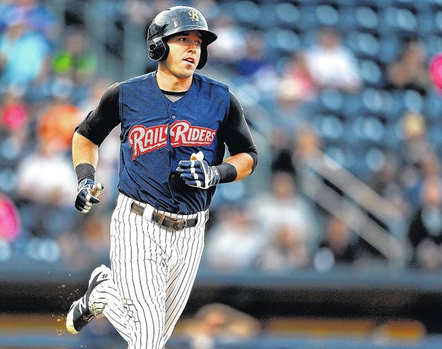 Scranton/Wilkes-Barre RailRiders outfielder Jake Cave (pictured) and reliever Nick Rumbelow were selected to the New York Yankees' 40-man roster on Monday.