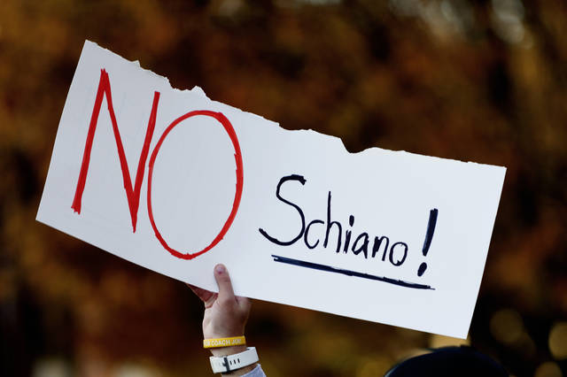 """A Tennessee fan holds a sign reading """"No Schiano!"""" during a gathering of Tennessee fans reacting to the possibility of hiring Ohio State defensive coordinator Greg Schiano for its head coaching vacancy Sunday in Knoxville, Tenn."""