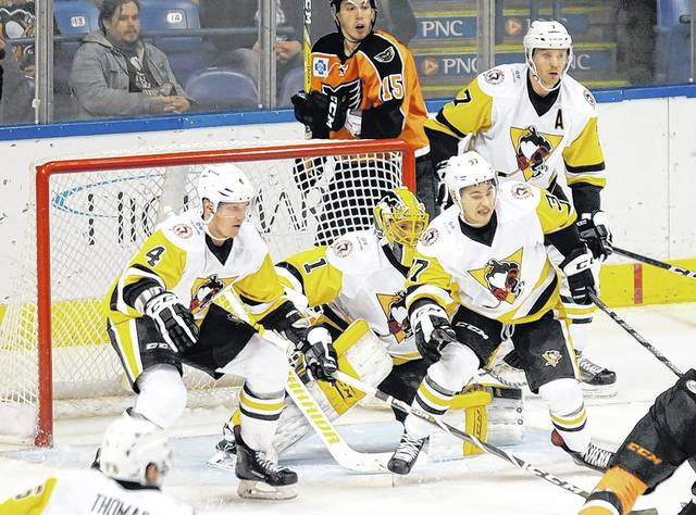 Wilkes-Barre/Scranton Penguins goalkeeper Casey DeSmith, center, and his teammates are hoping to put up a wall of defense in a home-and-home series against Syracuse on Friday and Saturday.