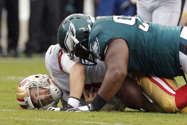 Philadelphia Eagles defensive tackle Fletcher Cox, top, and Aaron Donald are two of the NFL's best interior defensive linemen, sharing an agent and a passion for disruptive play. While Jared Goff and Carson Wentz are getting most of the attention before the Rams (9-3) host the Eagles (10-2), Cox and Donald will try to overshadow that showdown with their own feats.