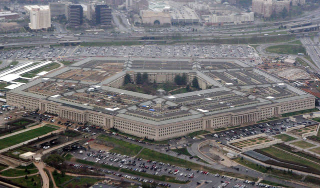 The Pentagon is seen in this aerial view in Washington, D.C. Due to a recent court decision, transgender people can enlist in the military beginning Jan. 1, despite President Donald Trump's opposition. (AP Photo/Charles Dharapak)