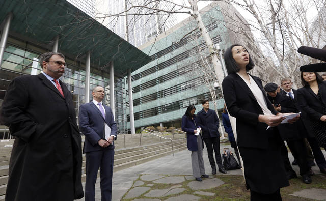 Mariko Hirose, right, a litigation director at the Urban Justice Center, speaks to reporters accompanied by Mark Hetfield, president & CEO of HIAS, left, and Rabbi Will Berkowitz, Jewish Family Service of Seattle CEO, in front of a federal courthouse in Seattle. On Saturday, U.S. District Judge James Robart partially lifted a Trump administration ban on certain refugees after the American Civil Liberties Union and Jewish Family Service argued that the policy prevented people from some mostly Muslim countries from reuniting with family living legally in the United States.