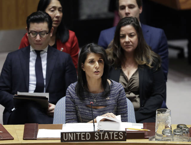 """FILE - In this Dec. 22, 2017, file photo, U.S. Ambassador Nikki Haley speaks in favor of a resolution at United Nations headquarters. The U.S. government said Sunday, Dec. 24, it had negotiated a significant cut in the United Nations budget. Haley said that the """"inefficiency and overspending"""" of the organization is well-known, and she would not let """"the generosity of the American people be taken advantage of."""" (AP Photo/Mark Lennihan, File)"""