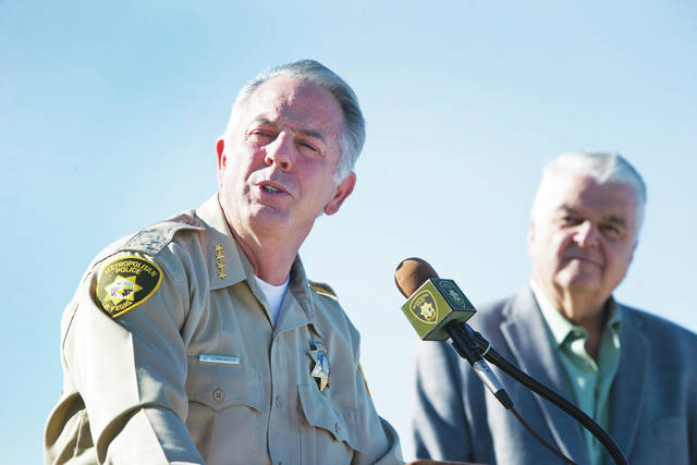 Clark County Sheriff Joe Lombardo, left, and Clark County Commission Chairman Steve Sisolak respond to questions during a news conference about New Year's Eve security at Metro Police Headquarters in Las Vegas on Wednesday.
