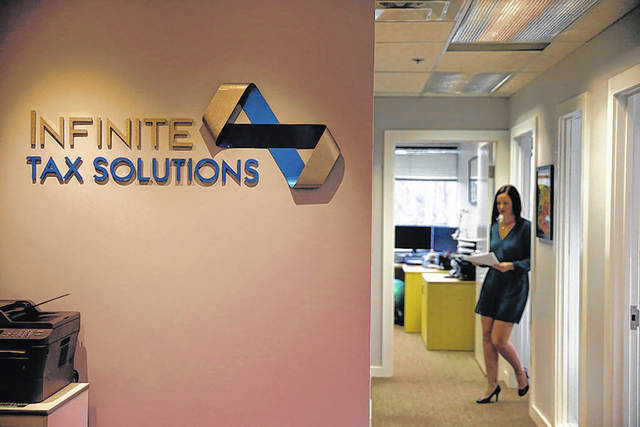 Tax professional and tax preparation firm owner Alicia Utley works at her office at Infinite Tax Solutions in Boulder, Colo.