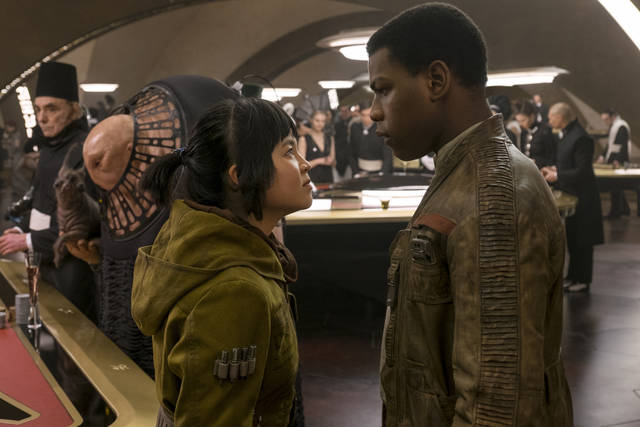 Kelly Marie Tran, left, and John Boyega portray characters Rose Tico and Finn, respectively, in 'Star Wars: The Last Jedi.'