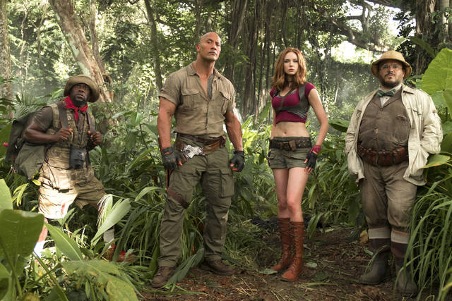 From left, Kevin Hart, Dwayne Johnson, Karen Gillan and Jack Black act in a scene from 'Jumanji: Welcome to the Jungle.' The film's story follows four teenagers who discover an old video game console and are literally drawn into the game's jungle setting becoming the adult avatars they chose.
