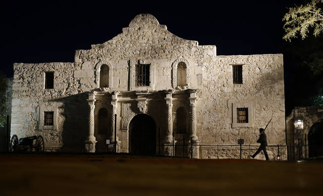 ohn Potter, a member of the San Antonio Living History Association, patrols the Alamo in 2013 in San Antonio, during a pre-dawn memorial ceremony to remember the 1836 Battle of the Alamo and those who fell on both sides. San Antonio marks its tricentennial in 2018.