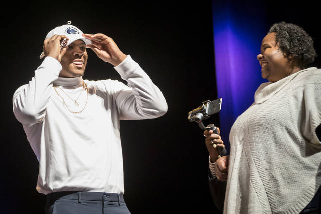 Harrisburg High School recruit Micah Parsons dons a Penn State hat announcing his intentions to attend the school during college football's new early signing period, which opened Wednesday.