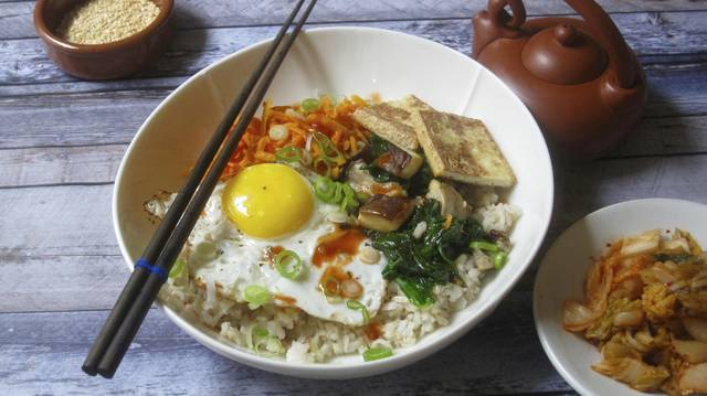 This Korean grain bowl contains whole grains, vegetable protein and good fat. It's the middle ground between empty calories and self-starvation that can help maintain a resolution diet in the new year.