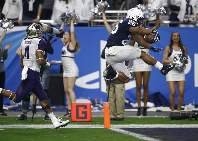 Penn State's Saquon Barkley bounces into the end zone at the end of his bowl game record 92-yard touchdown run in the second quarter of Saturday's Fiesta Bowl.