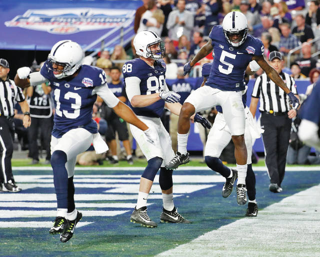 Penn State wide receiver DaeSean Hamilton (5) celebrates the final touchdown catch of his career with fellow seniors Mike Gesicki (88) and Saeed Blacknall in Saturday's Fiesta Bowl.
