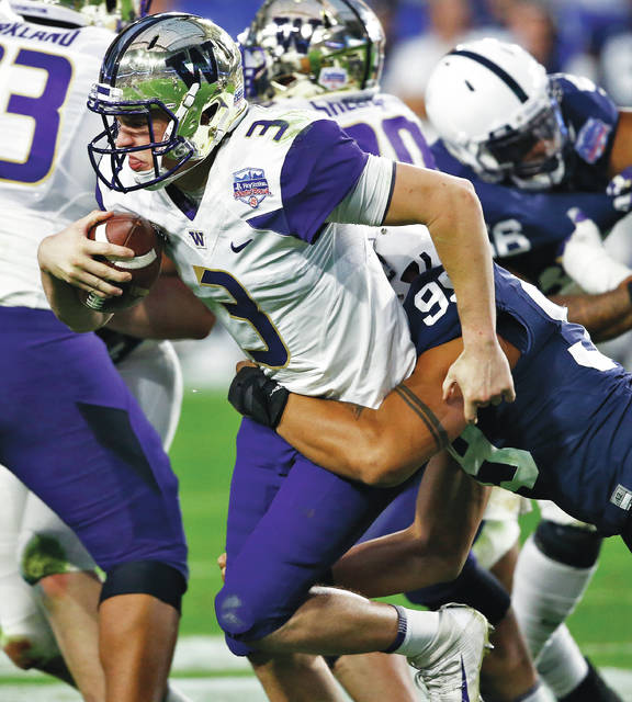 Washington quarterback Jake Browning was dropped four times for sacks during Saturday's Fiesta Bowl, including by true freshman Yetur Gross-Matos.