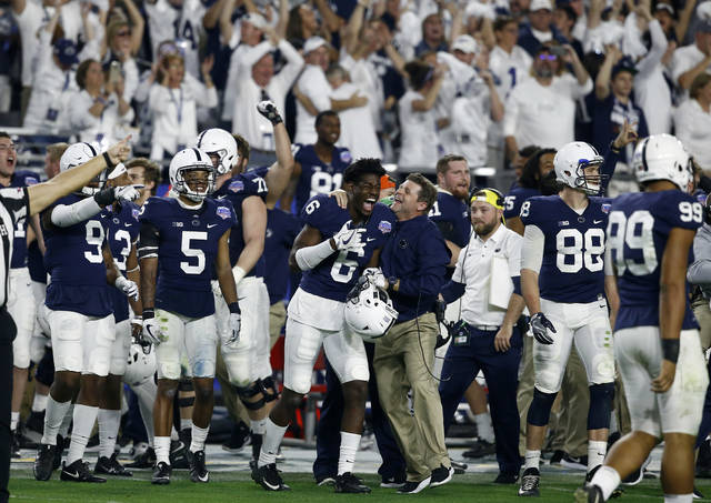 Penn State players and coaches celebrate during the final seconds of their Fiesta Bowl win over Washington on Saturday in Glendale, Ariz.