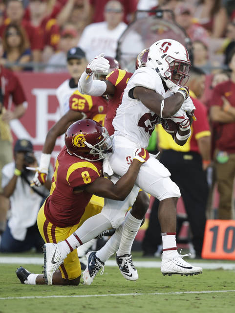 Things are much different for Stanford and star running back Bryce Love, right, since the last time they played USC. The Cardinals have a much tougher defense, a more dangerous quarterback in K.J. Costello and still have big-play back Bryce Love.