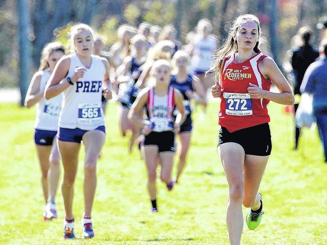 Holy Redeemer's Lindsey Williams, right, ran to a silver medal in the District 2 Class 2A girls cross country championship at Lakeland High School in October.