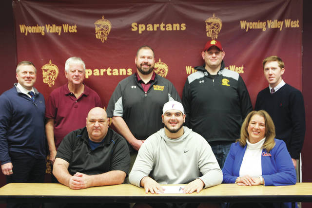 Wyoming Valley West's football standout Chris Bleich signed with the University of Florida on Wednesday as the early signing period began. Seated, from left: Walt Bleich, father; Chris Bleich; Lisa Bleich, mother. Standing, from left: Dave Novrocki, principal; Sandy Mackay, athletic director; Pat Keating, Valley West head coach; Ryan Mahovich, Valley West line coach; Chris Barnic, assistant principal.