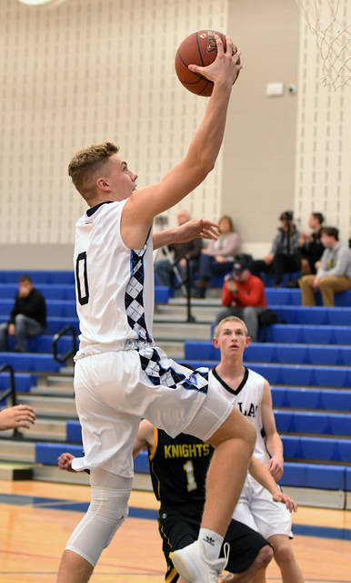 Dallas' Alex Charlton scores on a layup after the opening tip against Lake-Lehman on Tuesday night.