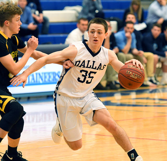 Dallas' Jay Bittner dribbles past a Lake-Lehman defender in the first half.