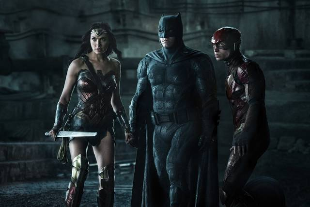 Gal Gadot, Ben Affleck and Ezra Miller star as Wonder Woman, Batman and the Flash, respectively, in 'Justice League.'