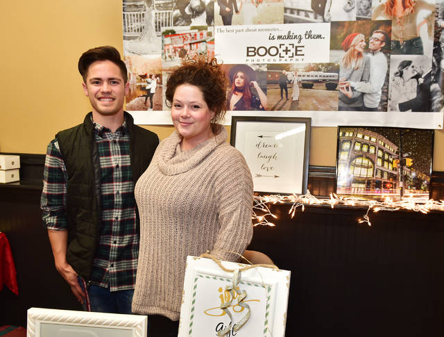 Brittany Boote, owner of Boote Photography, and assistant Dominic Augustine.