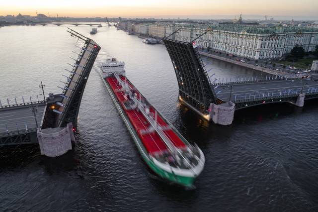 A tanker floats past the Dvortsovy drawbridge rising above the Neva River during this year's White Nights in St. Petersburg, Russia, with Zimny (Winter) palace on the right. White Nights refers to about a month from mid-June to mid-July in St. Petersburg around the time of the summer solstice when the city sky never gets completely dark. St. Petersburg is one of 11 Russian host cities for the 2018 World Cup soccer matches taking place June 14 to July 16.