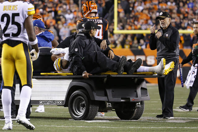 Pittsburgh Steelers inside linebacker Ryan Shazier, center, is carted off the field Monday in Cincinnati.