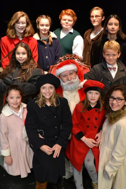 kevin costley as kris kringle is surrounded by the rest of the cast of miracle on 34th street the musical which continues through dec - The Christmas Box Cast