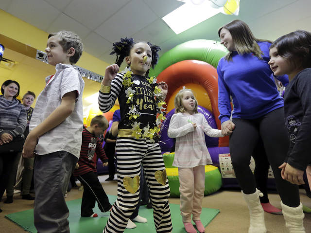 Nevaeh Wilson, 5, of Hanover Township, center, dances with other children as they celebrate a 'Countdown to Noon' at Super Bounce in Wyoming on Sunday.