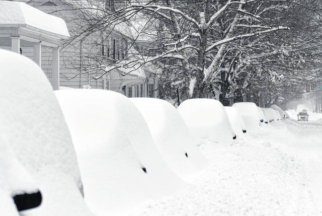 A snowstorm named Stella left many cars buried, as seen here on South River Street in Wilkes-Barre in March.