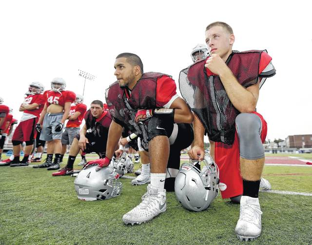 Hazleton Area's Adrian Otero, left, signed Wednesday to play at the University of Maine where he'll be a linebacker.