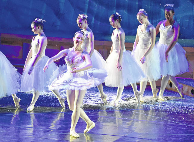 Snow Queen Mary Kathryn Siejak leads other dancers who represent Snowflakes through a wintry scene in the first act of The Degnan Ballet Center at the Wilkes University Conservatory's production of 'The Nutcracker.' The production continues through Sunday at the Dorothy Dickson Darte Center.