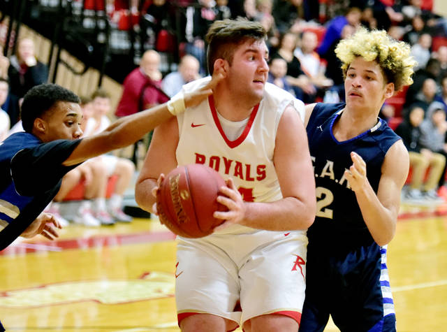 Holy Redeemer's Nick Prociak goes up for a shot against GAR's Will Johnson, left, and Anthony Hawk on Friday night.