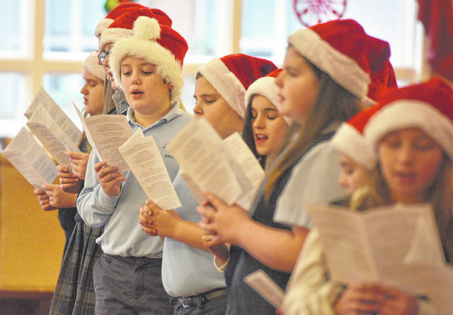 Fourth- and fifth-grade students at Wyoming Area Catholic School donned festive Santa hats for their holiday performance at Wesley Village in Jenkins Township.