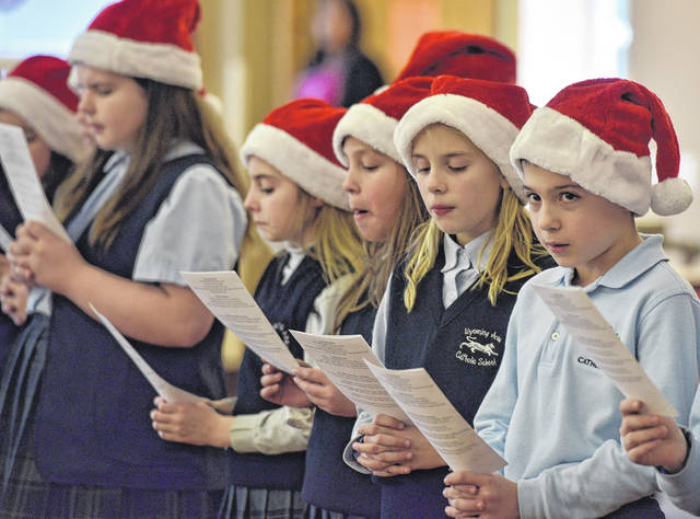 Having carolers from Wyoming Area Catholic School sing to residents of Wesley Village is an annual tradition and part of the school's community outreach.