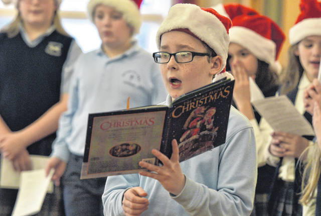 Liam O'Malley reads 'The Night Before Christmas' to residents of Wesley Village.