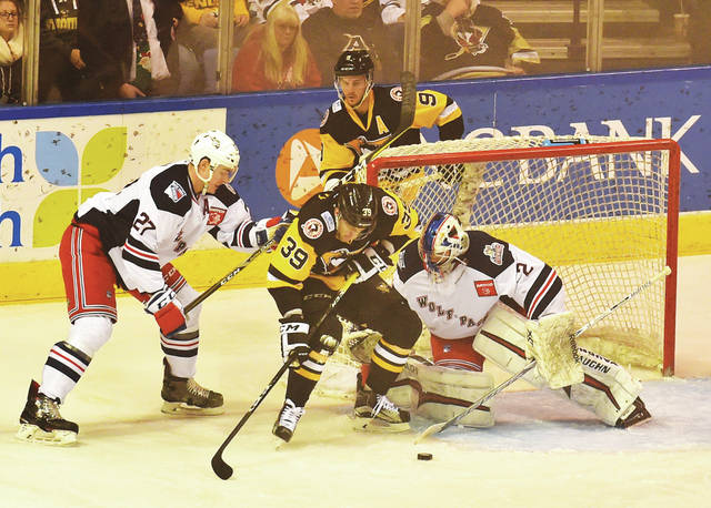 Penguins' Ryan Haggerty (39) attempts a shot on the Wolf Pack goal at Mohegan Sun Arena Friday night.
