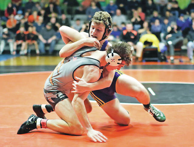 Tunkhannock's Sam Rice, front, earned his 100th career win Wednesday in the Tunkhannock Holiday Tournament and has a chance to meet Scranton Prep's Ivan Balavage (back) in a rematch of last year's 195 pound tourney finals.