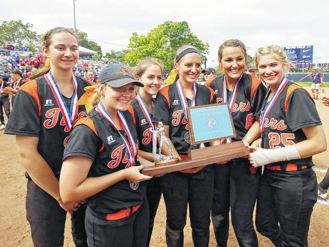 The Tunkhannock seniors pose with their runner-up trophy after falling to Mount Pleasant in the PIAA Class 4A softball championship game.