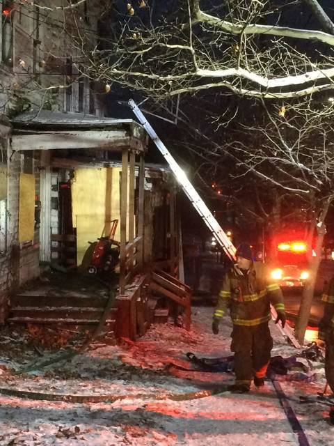 Wilkes-Barre firefighters finish putting out a fire at a vacant house on East Northampton Street on Saturday.