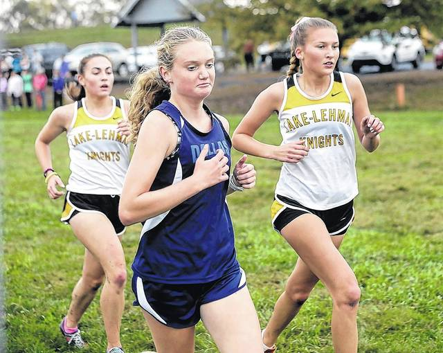 Dallas' Megan Borton, center, and Lake-Lehman's Jade Fry, right, are Times Leader Girls Cross Country First Team All-Stars.