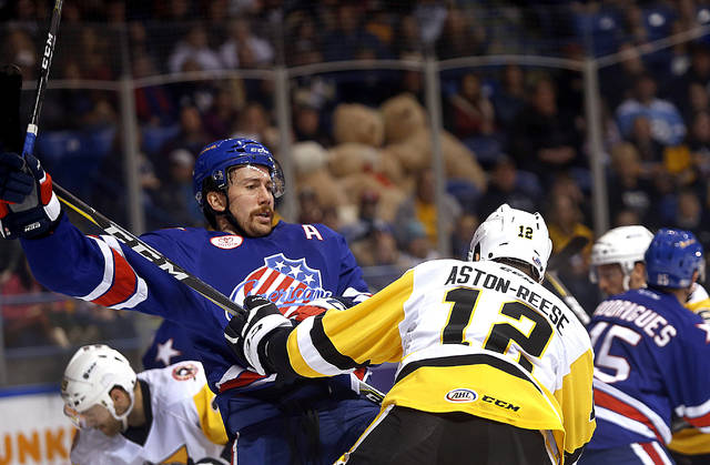 Wilkes-Barre/Scranton Penguins winger Zach Aston-Reese puts a hit into Rochester defenseman Andrew MacWilliam in the first period of Saturday's game at Mohegan Sun Arena.