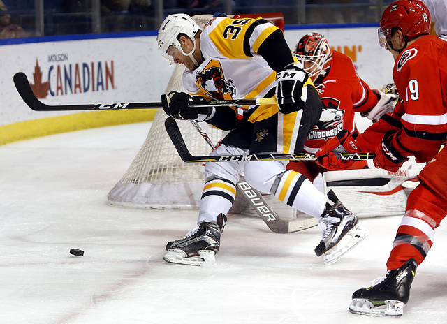 Wilkes-Barre/Scranton winger Ryan Haggerty goes for the puck around the Charlotte net on Friday.