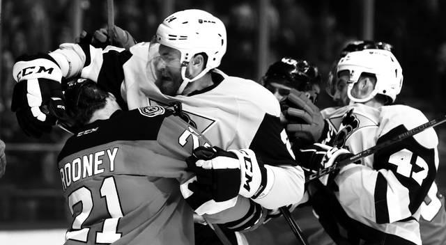 Penguins Jarred Tinordi delivers a hard hit to Binghamton defenseman Kevin Rooney during Friday's game.