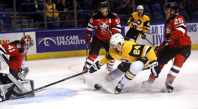 Penguins Jarred Tinordi has his shot on goal blocked by Binghamton goalie Ken Appleby during the first period of play on Friday at Mohegan Sun Arena.