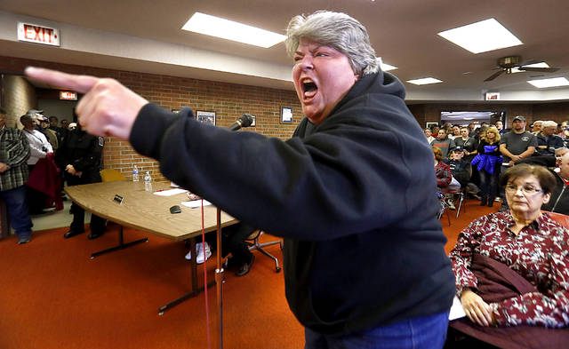 Resident Cheryl McMann gets a little heated at a recent Plymouth council meeting where fire protection and the 2018 budget were discussed. Fred Adams | For Times Leader