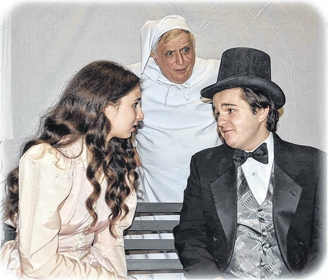 Scrooge watches a younger version of himself part ways with his girlfriend, Belle, in 'A Christmas Carol,' which opens at Little Theatre of Wilkes-Barre this weekend.