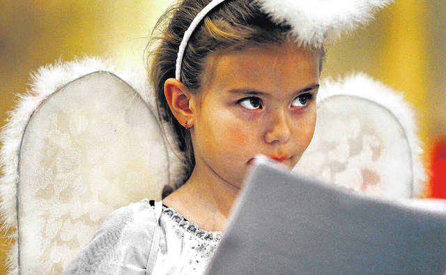 Dannica Lee looks up as she reads the script during a rehearal for 'The Gold Wrapping Paper: Living Nativity 2017,' which will be performed at 4 p.m. Sunday at St. John the Baptist Church in Larksville.