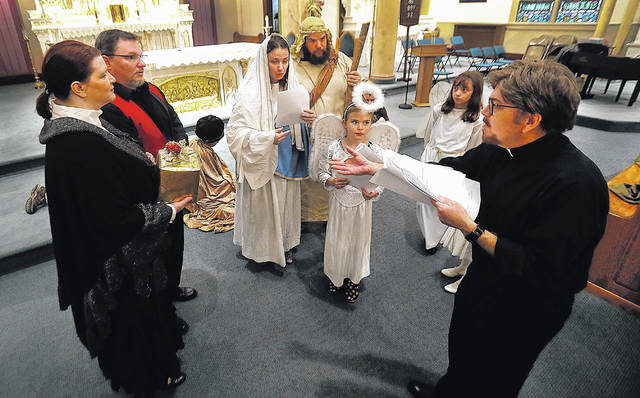 The Rev. Gerald Gurka directs the cast of his latest Nativity play, 'The Gold Wrapping Paper' during a rehearsal at St. John the Baptist Church in Larksville. The play will be presented on Sunday and followed by a Christmas Eve Mass.