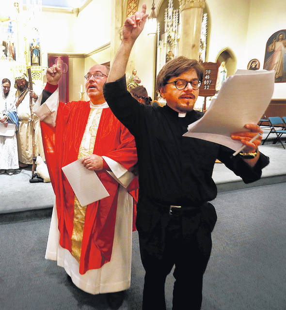 Father Jerry Gurka directs Marty Gabel of Forty Fort, who is portraying Father Damian in the play.